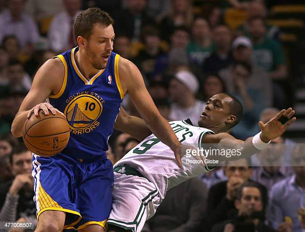 Boston Celtics point guard Rajon Rondo takes an offensive charge from Golden State Warriors power forward David Lee in the first half The Boston...
