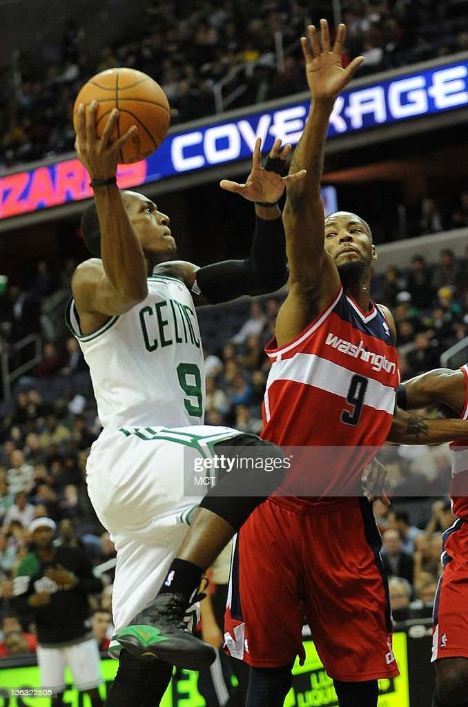 Boston Celtics point guard Rajon Rondo (9) takes the ball up against Washington Wizards power forward Rashard Lewis (9), right, during first-quarter action at the Verizon Center in Washington, D.C., Sunday, January 1, 2012.