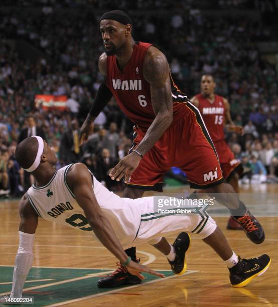 Boston Celtics point guard Rajon Rondo takes the fall as he is called for a defensive foul trying to defend Miami Heat small forward LeBron James in...