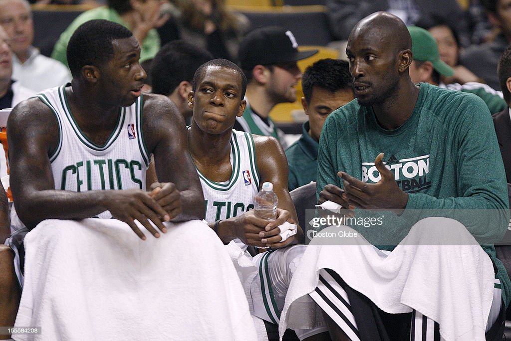 Boston Celtics power forward Brandon Bass (#30), Boston Celtics point guard Rajon Rondo (#9), and Boston Celtics power forward Kevin Garnett (#5) wore long faces as they tried to figure out what went wrong in the team's home opener against the Milwaukee Bucks at TD Garden.