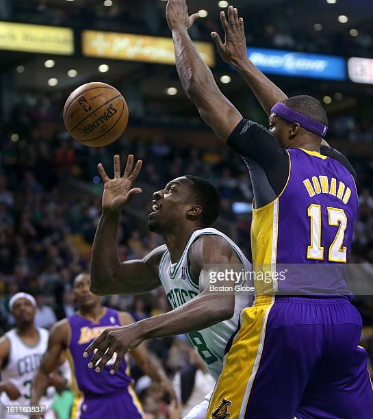 Boston Celtics power forward Jeff Green briefly lost control of the ball while being defended by Los Angeles Lakers center Dwight Howard but...