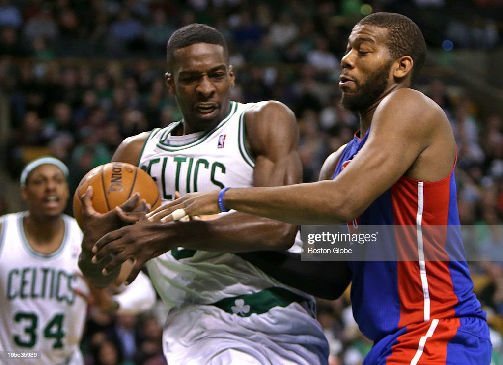 Boston Celtics power forward Jeff Green (#8) pulls down a defensive rebound as he battles with Detroit Pistons center Greg Monroe (#10) with the Celtics clinging to an 89-83 lead late in the fourth quarter . Celtics NBA basketball, action and reaction. The Celtics play the Detroit Pistons at TD Garden.