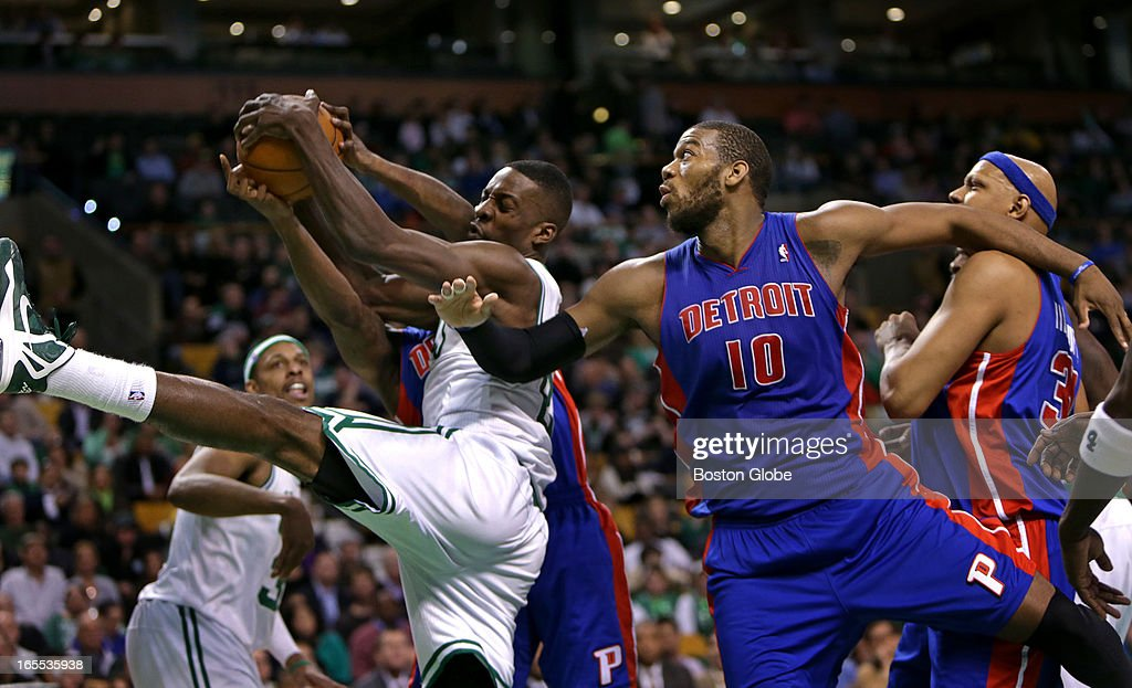 Boston Celtics power forward Jeff Green (#8) pulls down a defensive rebound with the Celtics clinging to an 89-83 lead late in the fourth quarter . Celtics NBA basketball, action and reaction. The Celtics play the Detroit Pistons at TD Garden.