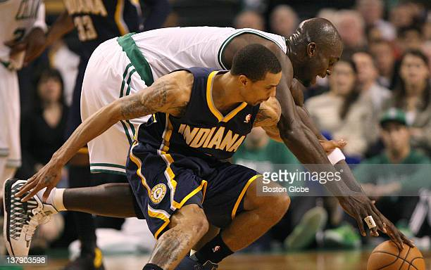 Boston Celtics power forward Kevin Garnett and Indiana Pacers shooting guard George Hill chase a loose ball Boston Celtics NBA basketball action and...