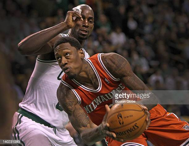 Boston Celtics power forward Kevin Garnett closes the lane as he defends Milwaukee Bucks center Larry Sanders during the first half Boston Celtics...