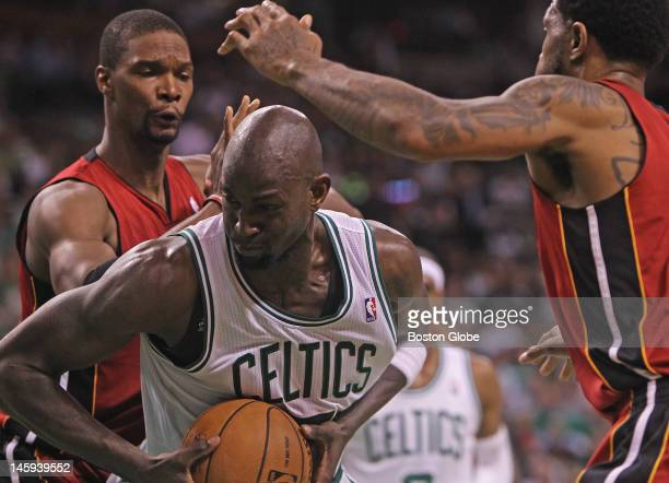 Boston Celtics power forward Kevin Garnett feels the pressure from the Miami Heat in the second quarter. Boston Celtics NBA basketball, action and...