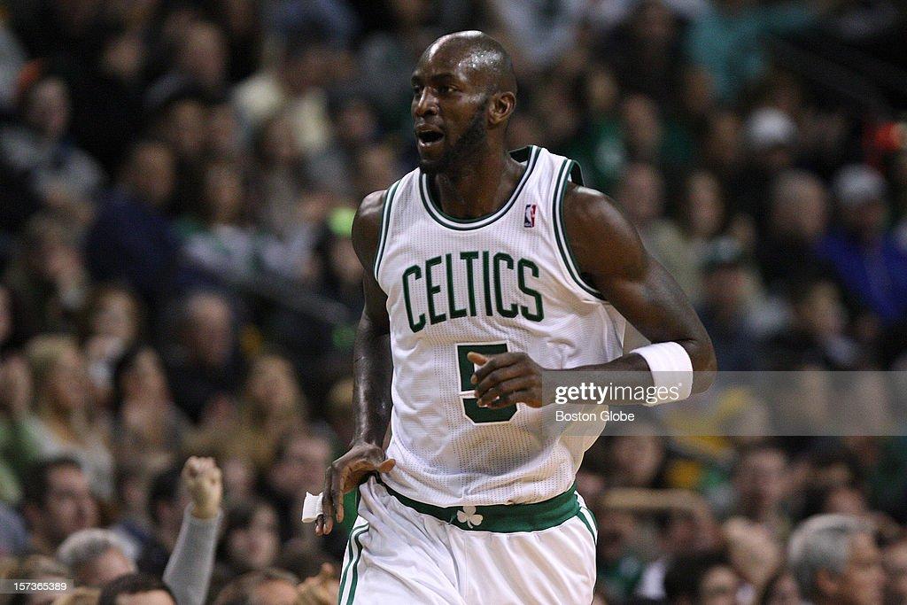 Boston Celtics power forward Kevin Garnett (#5) heads up court after draining a fall away jumper during the third quarter as the Celtics play the Portland Trail Blazers at TD Garden.