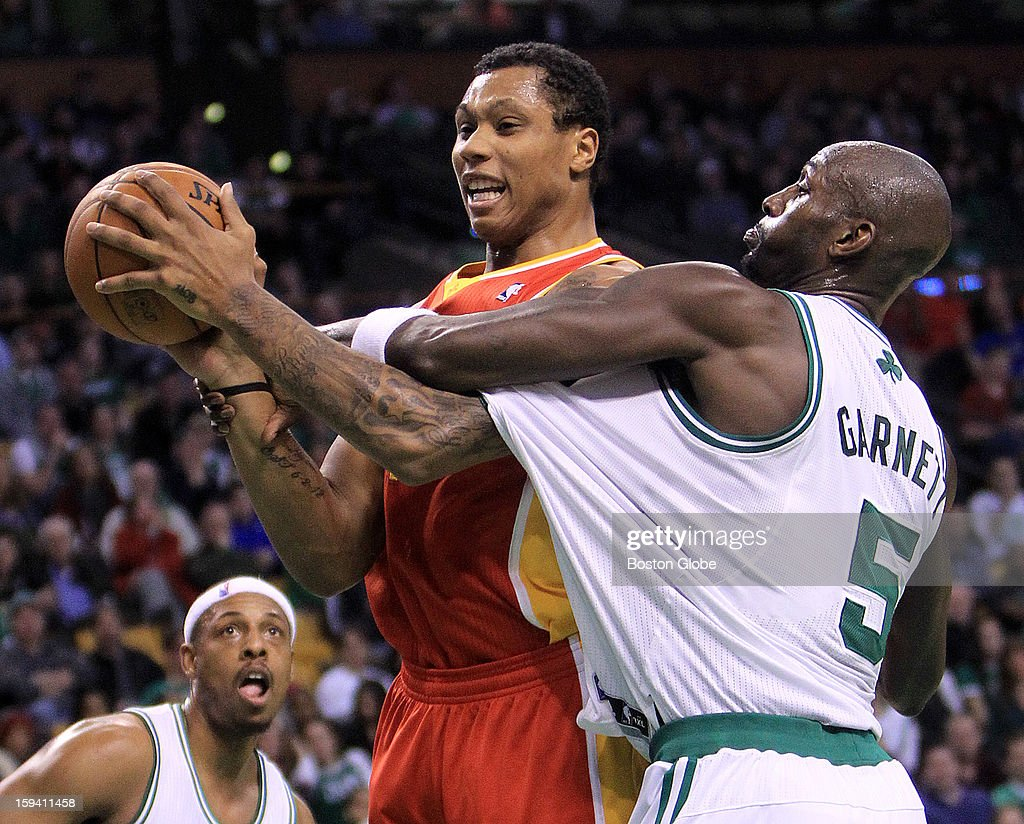 Boston Celtics power forward Kevin Garnett (#5) intentionally fouls Houston Rockets power forward Greg Smith (#4) in the fourth quarter as the Boston Celtics play the Houston Rockets at TD Garden.