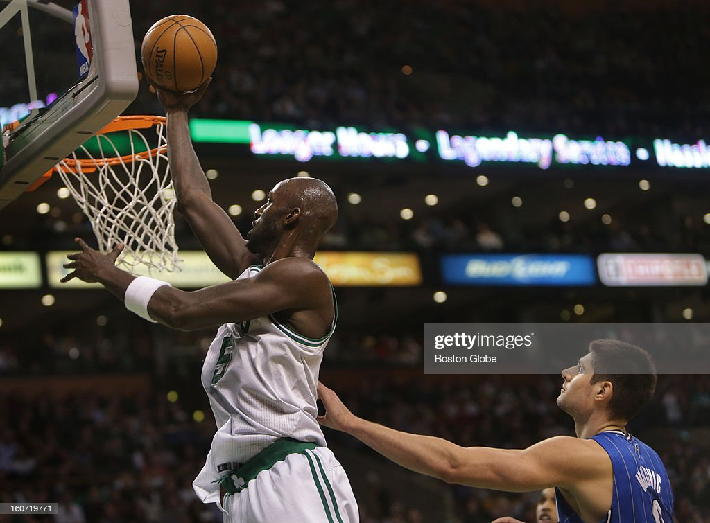 Boston Celtics power forward Kevin Garnett (#5) makes a move for an uncontested layup during the second quarter as the Boston Celtics take on the Orlando Magic at TD Garden.