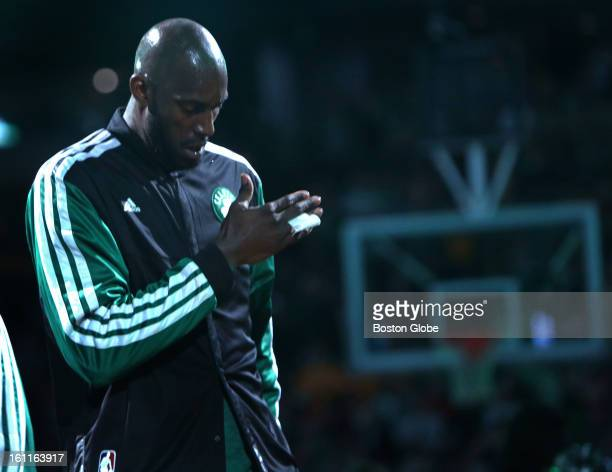 Boston Celtics power forward Kevin Garnett pounds his chest as he is introduced during the pregame ceremonies before the Boston Celtics play the Los...