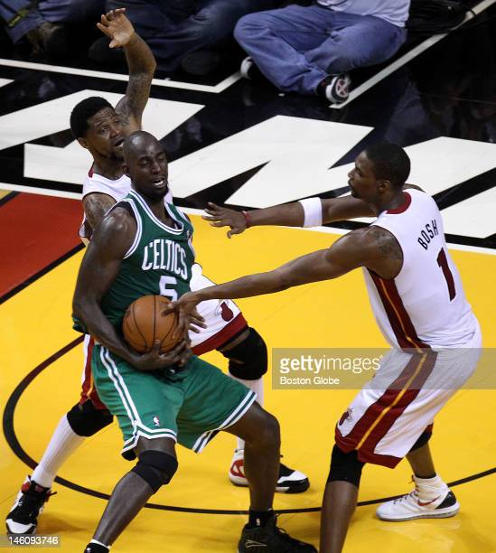 Boston Celtics power forward Kevin Garnett tries to fight through the Miami Heat double team during the fourth quarter. Boston Celtics NBA...