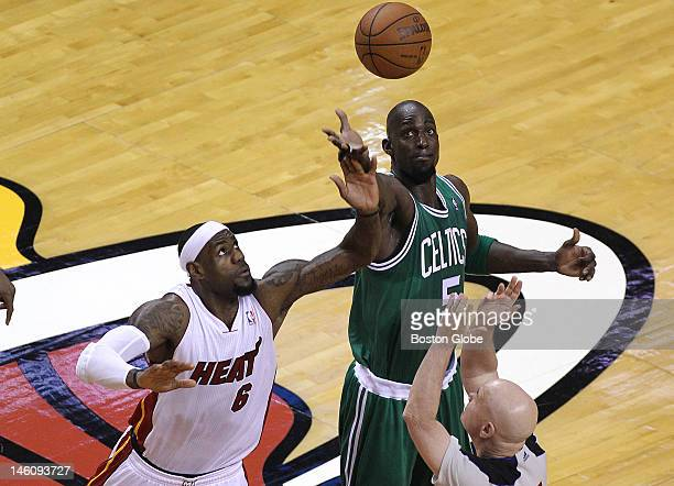 Boston Celtics power forward Kevin Garnett wins the opening tipoff against Miami Heat small forward LeBron James Boston Celtics NBA basketball action...