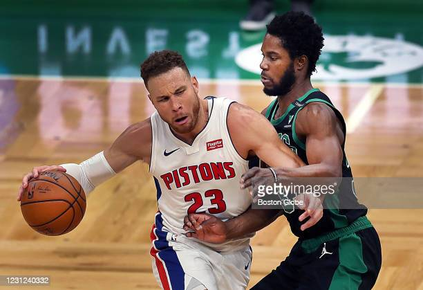 Boston Celtics' Semi Ojeleye guards Detroit Piston's Blake Griffin as he drives to the basket in the second quarter. The Boston Celtics host the...
