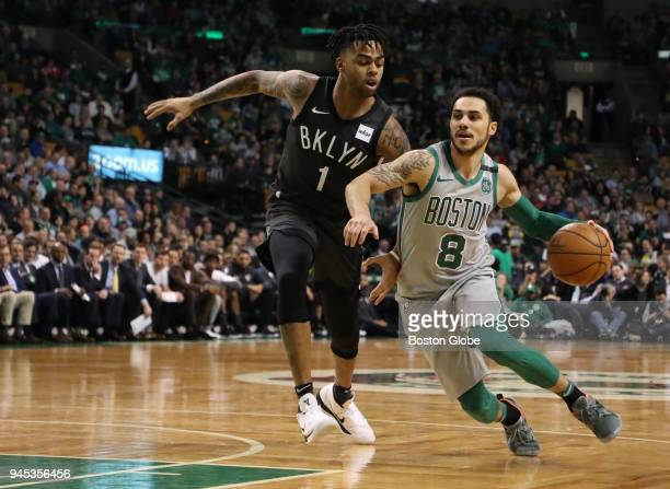 Boston Celtics' Shane Larkin drives to the basket against Brooklyn Nets' D'Angelo Russell during the third quarter The Boston Celtics host the...