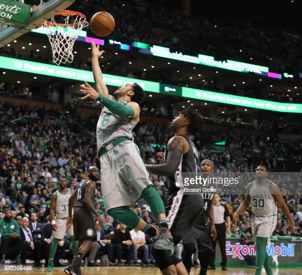 Boston Celtics' Shane Larkin makes a layup over Brooklyn Nets' D'Angelo Russell during the third quarter The Boston Celtics host the Brooklyn Nets in...