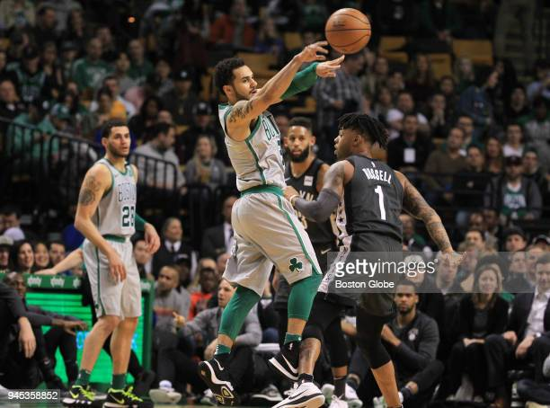Boston Celtics' Shane Larkin passes against Brooklyn Nets' D'Angelo Russell during the first quarter The Boston Celtics host the Brooklyn Nets in a...