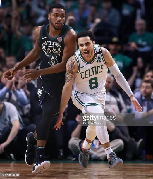 Boston Celtics Shane Larkin right reacts after hitting a fourth quarter shot as he runs upcourt past Milwaukee Bucks Sterling Brown left The Boston...