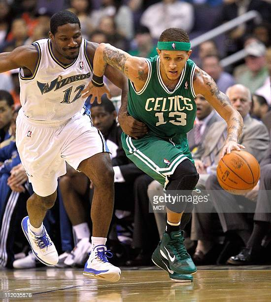 Boston Celtics shooting guard Delonte West pushes the ball up court while being defended by Washington Wizards guard Othyus Jeffers during their game...