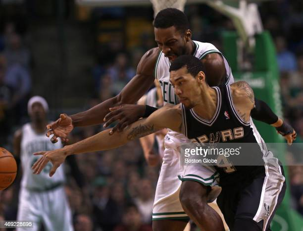 Boston Celtics small forward Jeff Green and San Antonio Spurs shooting guard Danny Green collide as they pursue a loose ball in the fourth quarter...