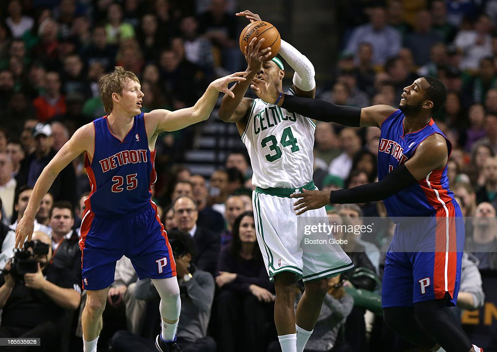 Boston Celtics small forward Paul Pierce (#34) battles for a rebound with Detroit Pistons shooting guard Kyle Singler (#25) and Detroit Pistons center Andre Drummond (#1) during the first half. Celtics NBA basketball, action and reaction. The Celtics play the Detroit Pistons at TD Garden.