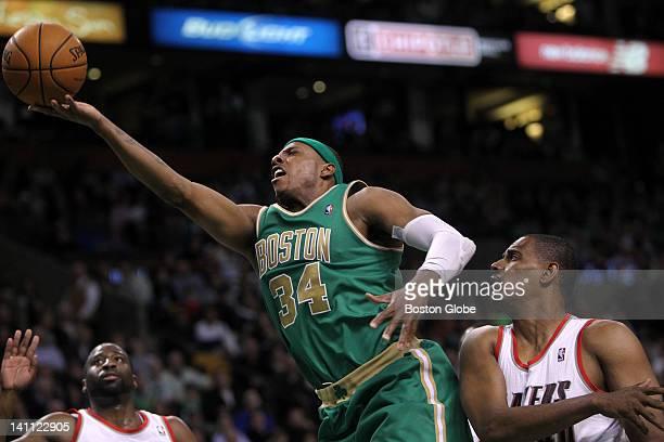 Boston Celtics small forward Paul Pierce drives up and under Portland Trail Blazers center Kurt Thomas and Portland Trail Blazers point guard Raymond...