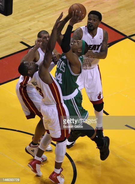 Boston Celtics small forward Paul Pierce faces triple coverage as he tries to penetrate the Miami Heat defense. Boston Celtics NBA basketball, action...