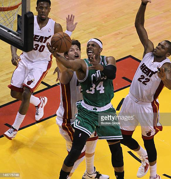 Boston Celtics small forward Paul Pierce fights thrugh a triple team defense by the Miami Heat as he puts up a shot in the first quarter Boston...