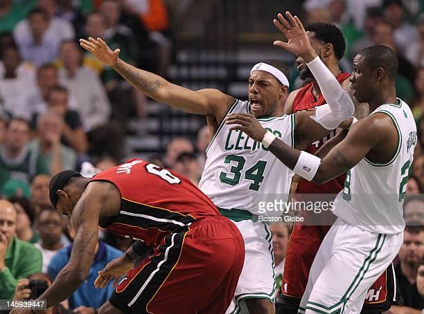 Boston Celtics small forward Paul Pierce reacts to Miami Heat small forward LeBron James in the first quarter. Boston Celtics NBA basketball, action...