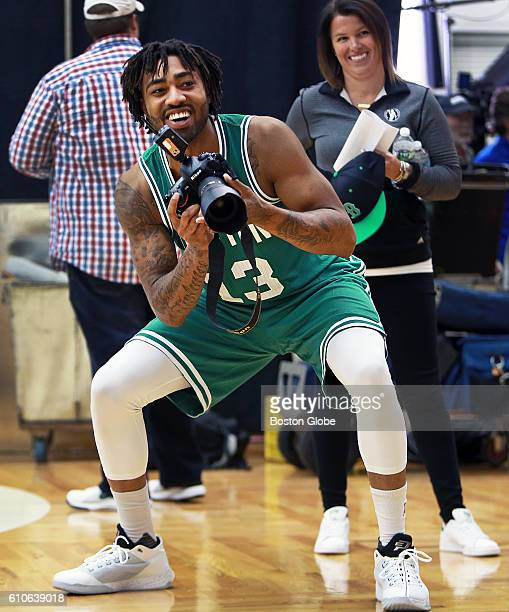 Boston Celtics swingman James Young tries being on the other side of the camera as he has some fun as he photographs teammate Marcus Smart not...