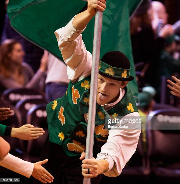 Boston Celtics team mascot Lucky the Leprechaun leads the team onto the court at TD Garden in Boston on Dec 6 2017 As they strive for an 18th NBA...