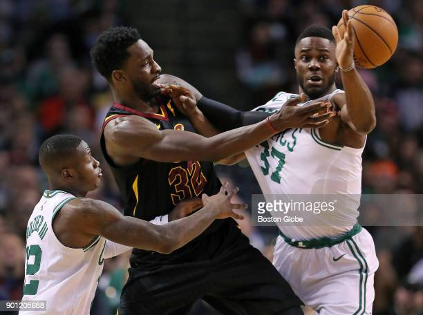 Boston Celtics' Terry Rozier left and Semi Ojeleye right battle with former Celtics forward Jeff Green of the Cavaliers during the fourth quarter The...