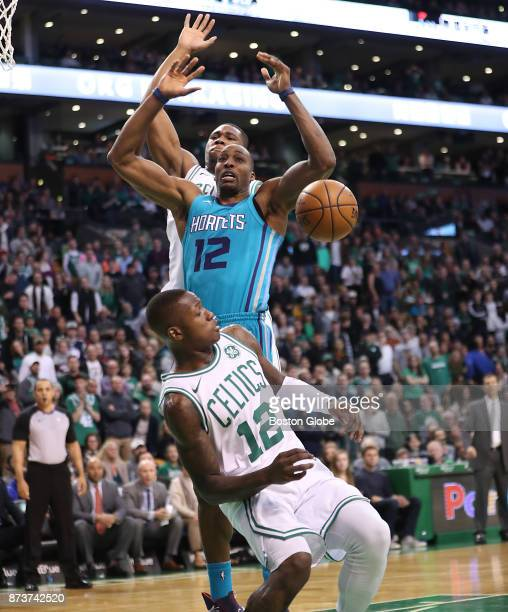 Boston Celtics' Terry Rozier steals the ball from Charlotte Hornets' Dwight Howard during the fourth quarter The Boston Celtics host the Charlotte...