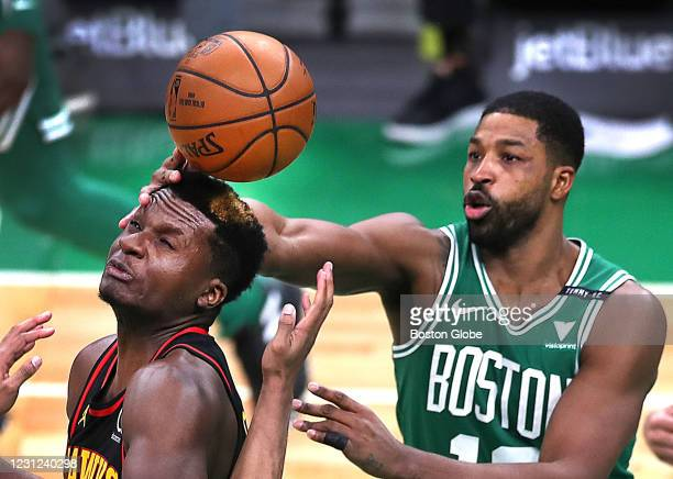 Boston Celtics' Tristan Thompson scoops a loose ball off the head of Atlanta Hawks' Clint Capela in the fourth quarter. The Boston Celtics host the...
