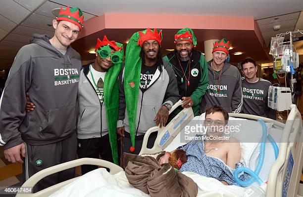 Boston Celtics Tyler Zeller Marcus Smart Gerald Wallace Walter McCarty Jay Larranaga and Darren Erman spend time with Nicholas at Boston Children's...