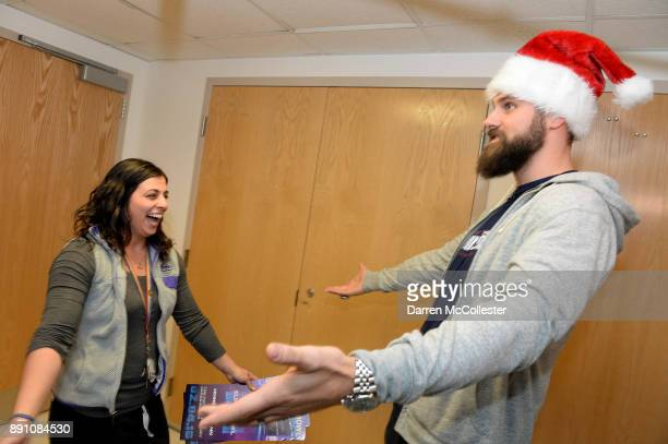 Boston Children's Hospital Marisa Silva RNBSNCPN is surprised by New England Patriot Alumni Sebastian Vollmer with Super Bowl LII tickets at Boston...