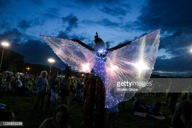 Boston Circus Guild member Liz Knights walks on stilts at the Braintree Fourth of July celebration in Cambridge, MA on June 26, 2021.