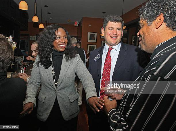 Boston City Council candidates Ayanna Pressley left and John Connolly center talk with Glenn Williams of Roslindale right as they campaign together...