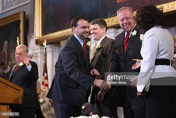 Boston City Councilors left to right Felix Arroyo John Connolly Stephen Murphy and Ayanna Pressley congratulate each other after being mistakenly...