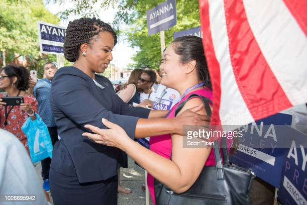 Boston City Councilwomen And House Democratic Candidate Ayanna Pressley greets a supporter on primary day on September 4 2018 in Chelsea...