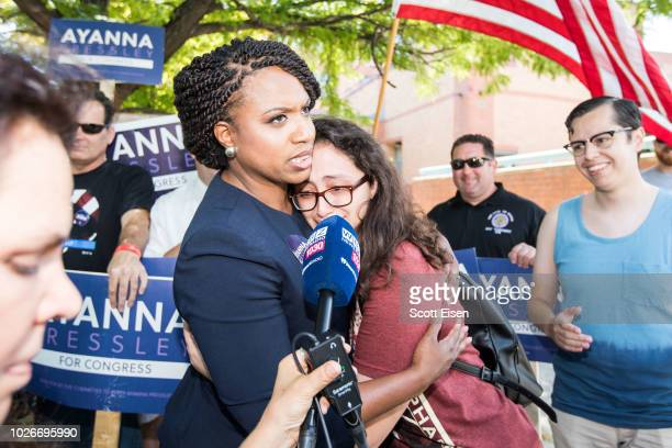 Boston City Councilwomen And House Democratic Candidate Ayanna Pressley hugs a supporter on primary day on September 4 2018 in Chelsea Massachusetts...