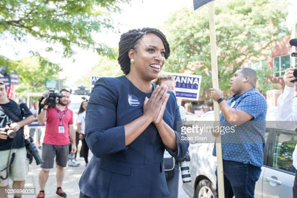 Boston City Councilwomen And House Democratic Candidate Ayanna Pressley applauds in front of her supporters during primary day on September 4 2018 in...