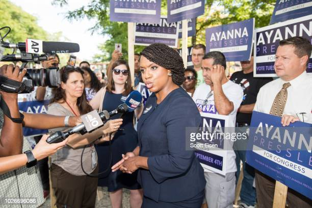 Boston City Councilwomen And House Democratic Candidate Ayanna Pressley speaks to media in front of her supporters during primary day on September 4...