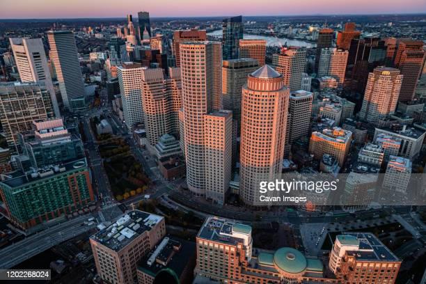 boston cityscape aerial view from helicopter at sunrise. - boston massachusetts fotografías e imágenes de stock
