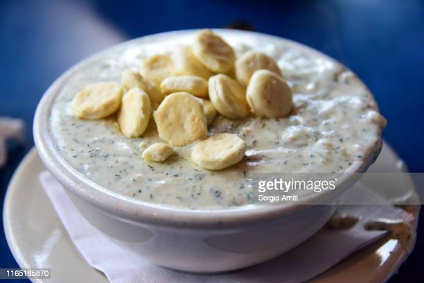 boston clam chowder with oyster crackers - new england clam chowder stock photos and pictures