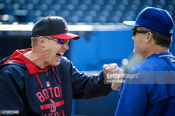 TORONTO ON MAY 8 Boston coach Brian Butterfield of the Boston Red Sox shares a laugh with Jays manager John Gibbons during batting practice before...