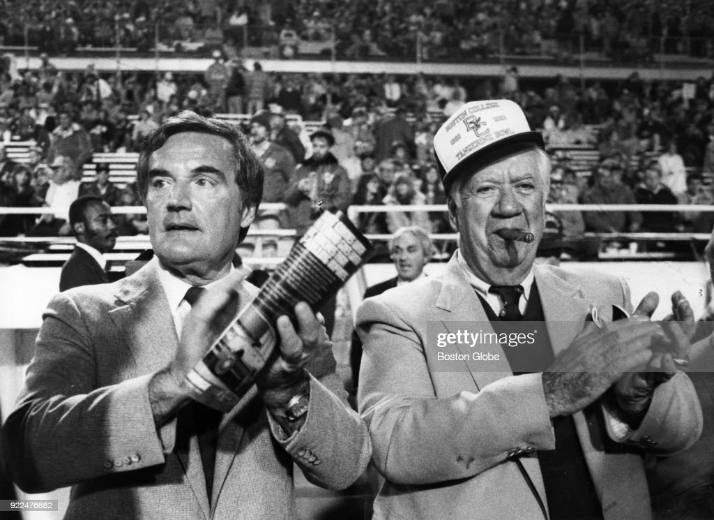 Boston College alumni Massachusetts Governor Edward King, left, and Tip O'Neill, right, applaud during the start of the Tangerine Bowl in Orlando, Fl., Dec. 18, 1982.