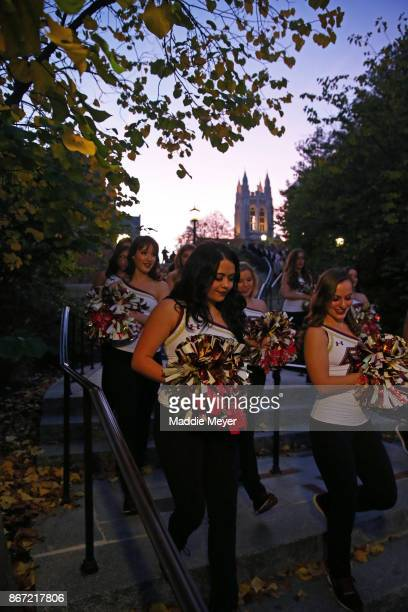 Boston College cheerleaders walk towards Alumni Stadium before the Eagles game against the Florida State Seminoles on October 27 2017 in Chestnut...