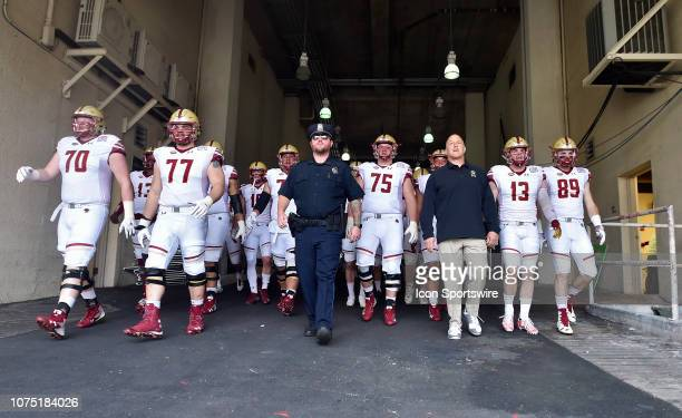 Boston College coach Steve Addazio walks with his team out onto the field before the start of the Servpro First Responder Bowl against Boise State on...