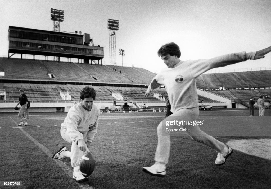 Boston College David Pereira, left, holds the ball for Doug Flutie, right, during a team practice in Orlando, Fl., Dec. 1982.