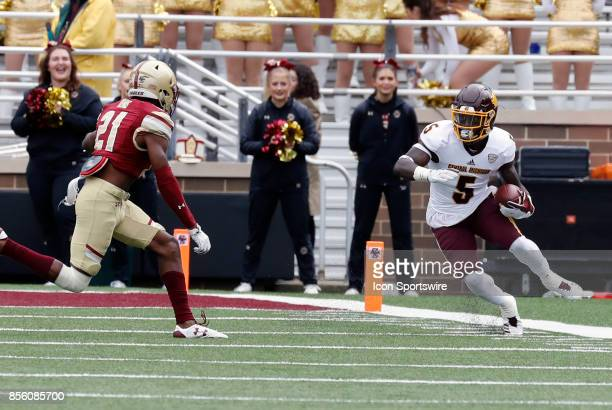 Boston College defensive back Lukas Denis moves in on Central Michigan running back Jonathan Ward after a reception during a game between the Boston...